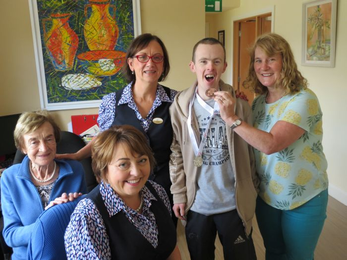 Adrian O'Neill, parish office volunteer, returns from the Special Olympics