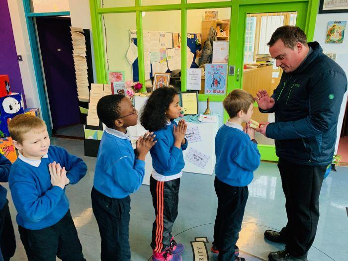 Blessing of throats at Holy Family School, Fr. Dariusz Plasek & Fr. Ger Fitzgerald