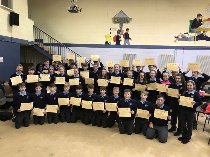 Students from Rice College who made a commitment to abstain from alcohol and drugs receive their pledge of Commitment during Catholic Schools week.